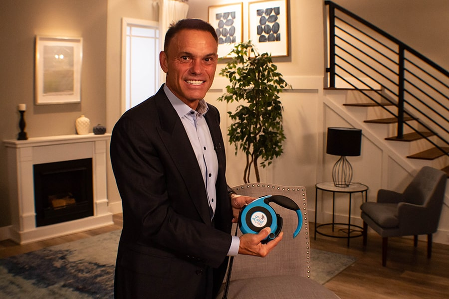 Kevin Harrington from Shark Tank posing with Leash Lock